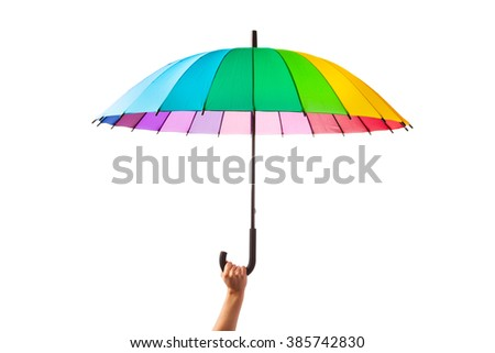 hand holding multicolored umbrella, isolated on white - stock photo
