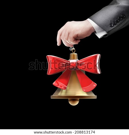hand holding object (Christmas handbell) isolated on black background High resolution 3d  - stock photo