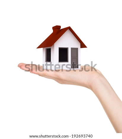Hand holding offer house. Concept growing business, real estate, ecology, freshness, freedom and lifestyle issues. Handful collection.  - stock photo