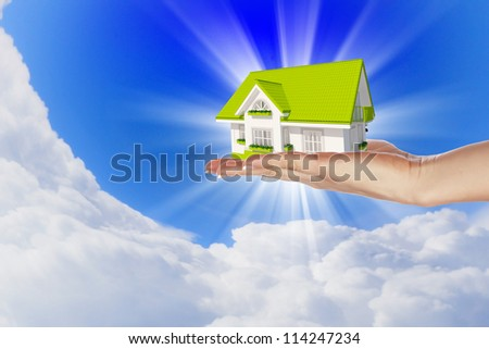 Hand holding / offer house. Real estate concept. Handful collection. - stock photo