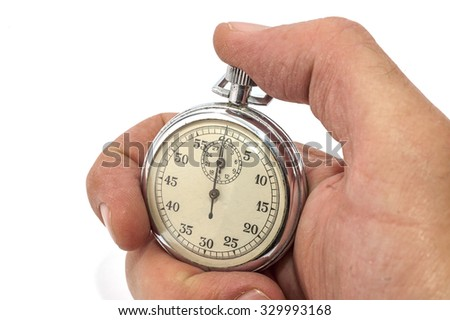 Hand Holding old Stopwatch On White Background, SOFT FOCUS - stock photo