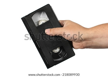 hand holding old vhs tape on a white background - stock photo