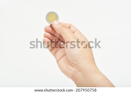 Hand holding one coin with finger to pay cash. - stock photo