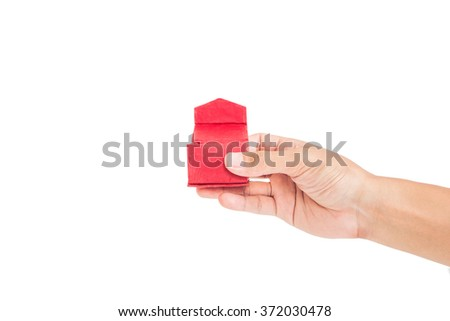 Hand holding opened red gift box, isolated on white background - stock photo