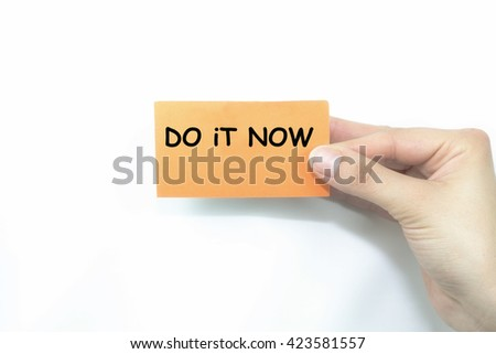 hand holding orange card written do it now over isolated