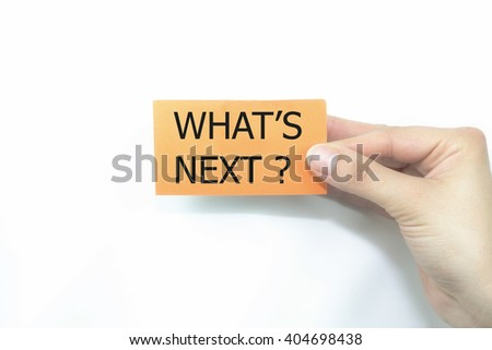 hand holding orange card written what is next over isolated on white