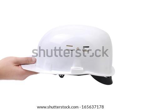 Hand holding orange hard hat. Isolated on a white background. - stock photo