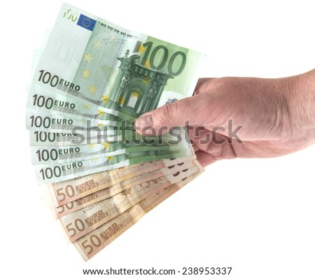 Hand holding out a fan of euro bill money isolated on white