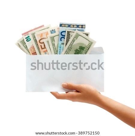 Hand holding out an envelope full of euro and dollars money. Business concept. Business concept - stock photo