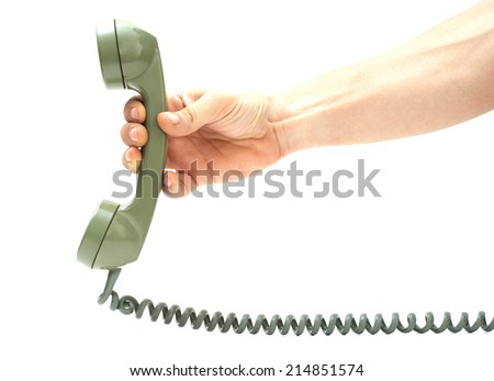 Hand holding out an old telephone's handset. - stock photo