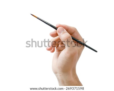 Hand holding paint brush. Male hand holding fine round  artists paint brush close-up isolated on white background - stock photo