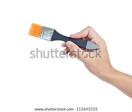 Hand holding painting brush on white background