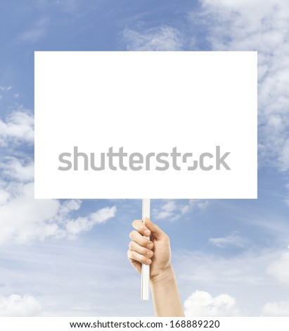 hand holding paper card on a sky background