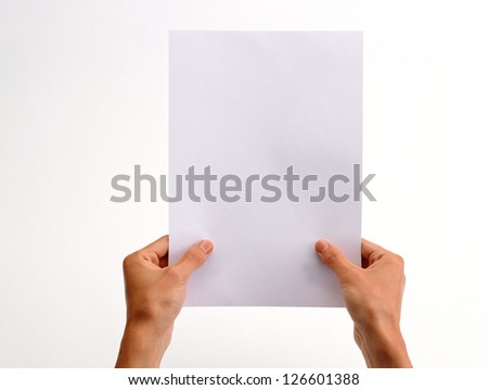 hand holding paper on a white background - stock photo