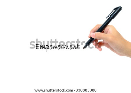 Hand holding pen writing words empowerment concept.