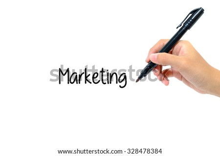 Hand holding pen writing words marketing concept.