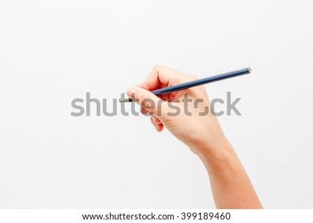 Hand holding pencil on a white background.