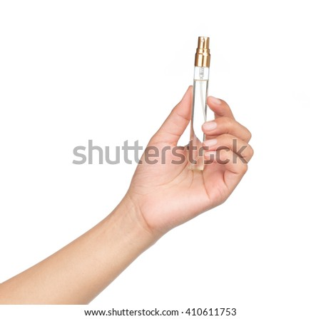 hand holding perfume glass bottle isolated on a white background