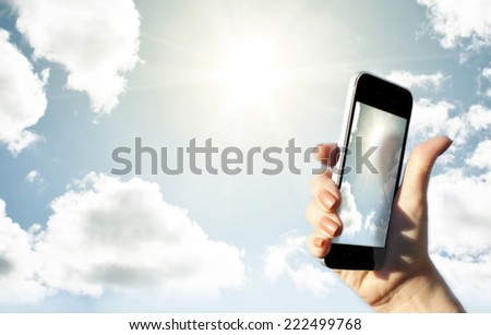 hand holding phone - stock photo