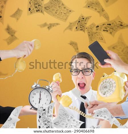 hand holding phone against orange background - stock photo