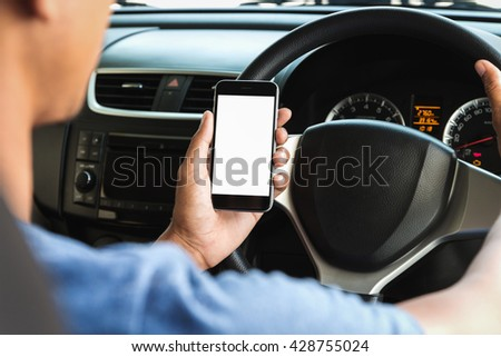 hand holding phone white screen display in car - stock photo