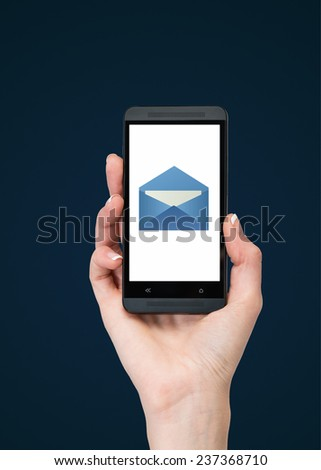 hand holding phone with email on blue background - stock photo