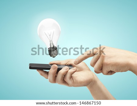 hand holding phone with lamp - stock photo