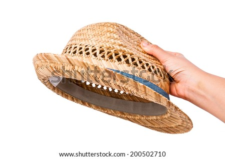 Hand Holding (Pick Choose Select Wear) Vintage Classic Smart Straw Fedora, Fashion Design Style Hat with Blue Strip Isolated on white background. - stock photo