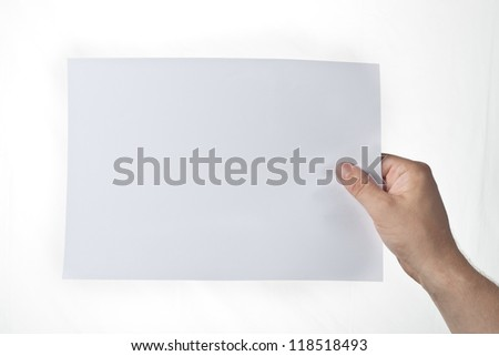 hand holding piece of paper over white background