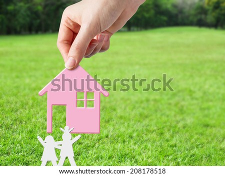 Hand holding pink home