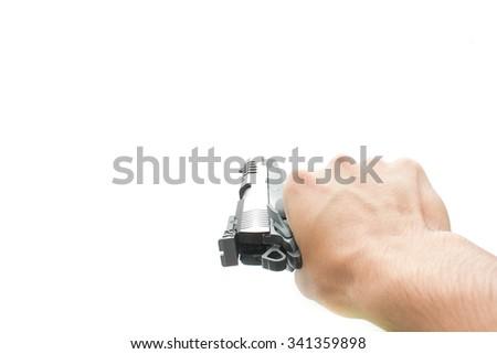 Hand holding pistol handgun isolated on white background - stock photo