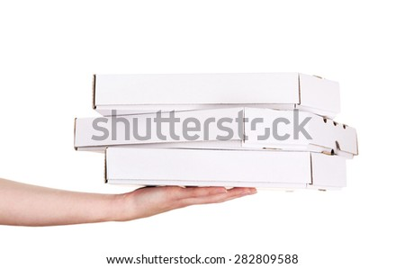 Hand holding pizza boxes isolated on white - stock photo