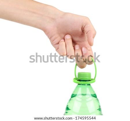 Hand holding plastic bottle. Isolated on a white background. - stock photo