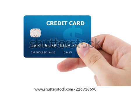 Hand holding plastic credit card - stock photo