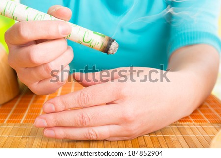Hand holding professional moxa stick - stock photo
