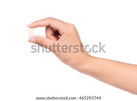 hand holding Pumpkin seed isolated on the white background