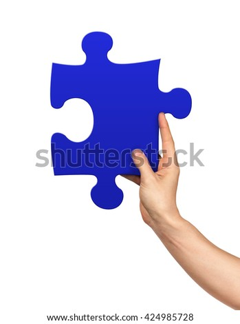 Hand holding puzzle piece on isolated white background