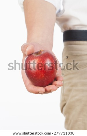 Hand Holding Red Apple Against White Background - stock photo