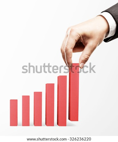 hand holding red business graph