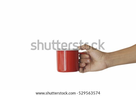 hand holding red cup of coffee on white background