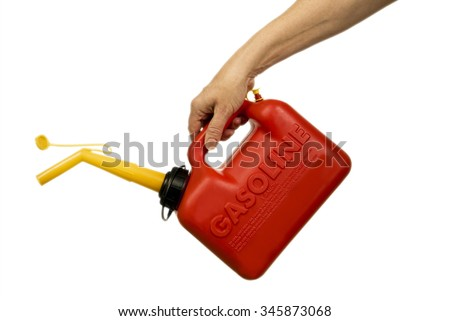 Hand holding red gasoline container isolated on white/ Hand Holding Red Gasoline Container Isolated - stock photo