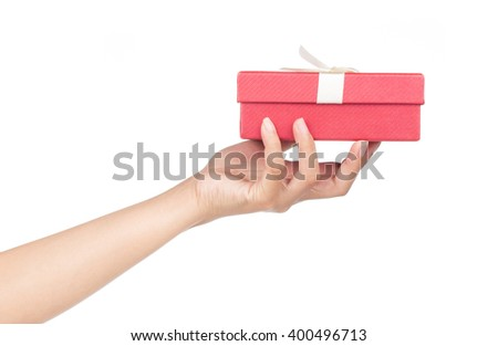 hand holding red gift box isolated on white background