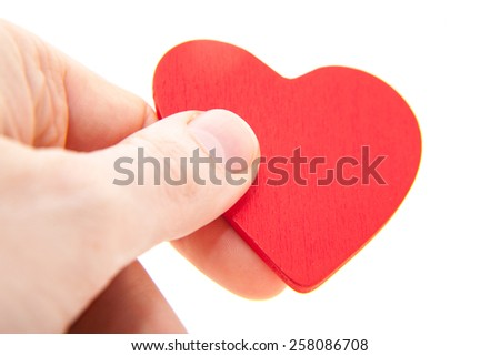 Hand holding red heart. All on white background. - stock photo