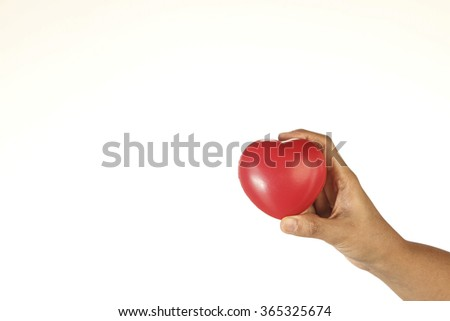 Hand Holding Red Heart Shape Foam on White Background