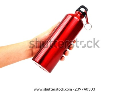 hand holding red metal thermos Bottles  isolated on white