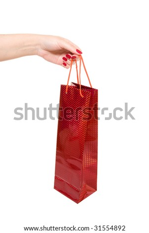 hand holding red shopping bag