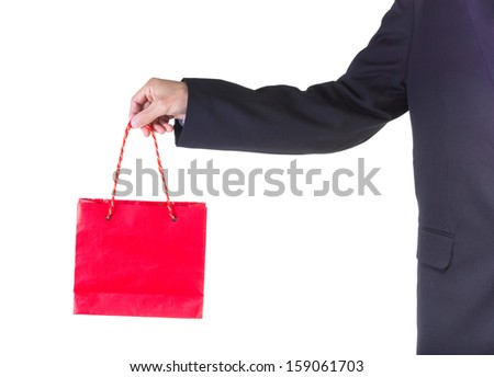 Hand holding red shopping bag isolated on white background.