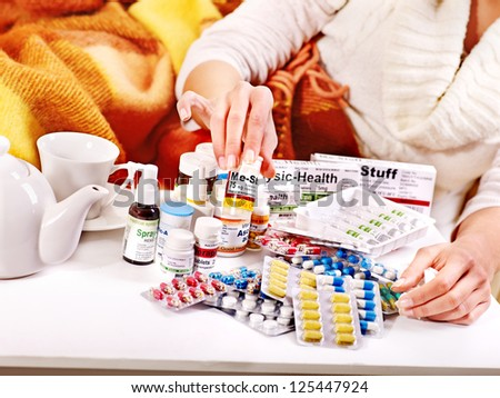 Hand holding remedy.  Medicine. - stock photo