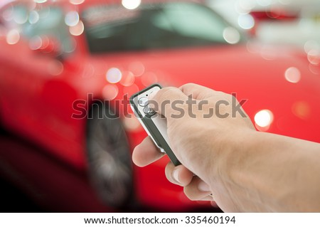 Hand holding remote control car - stock photo