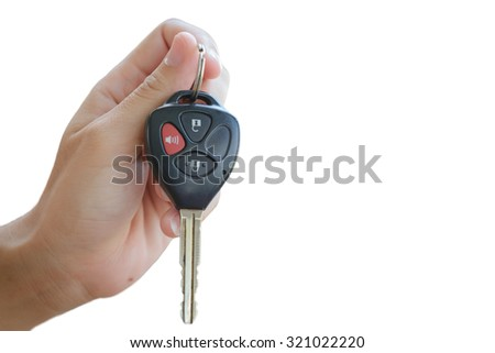 hand holding remote control of a car, key with alarm system, isolate white background, blank space